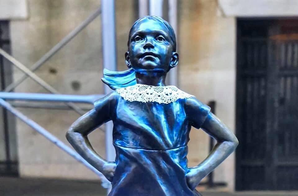 How lovely is this! Someone in NYC put a lace collar on the statue of The Fearless Girl. 😢 Oh my heart. RIP RBG. https://t.co/DAm9uBfke2