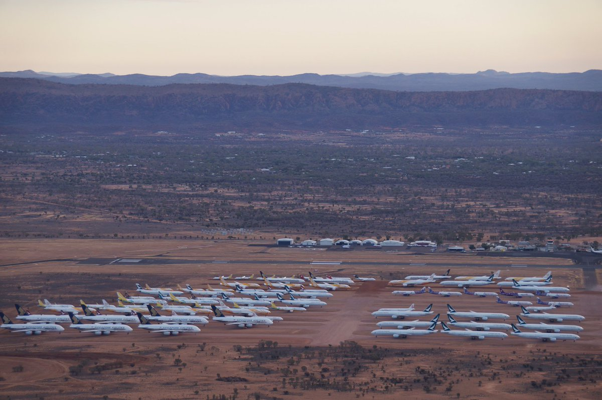 There's about 90 planes parked at Alice Springs airport. Planes started arriving at Asia Pacific Aircraft Storage in April and some flew in as recently as last week. A jarring and rather sad sight. https://t.co/crchxyFGnF
