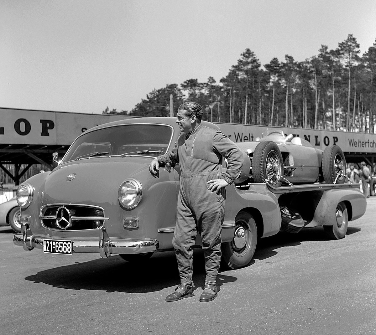 """Legends in 1955: Rudolf Uhlenhaut on the Mercedes-Benz high-speed racing car transporter """"Das blaue Wunder"""" with a W 196 R Monoposto Formula 1 racing car on the loading area. Let yourself be fascinated with us in Stuttgart! #MBmuseum https://t.co/Ybn0pwtVqN"""
