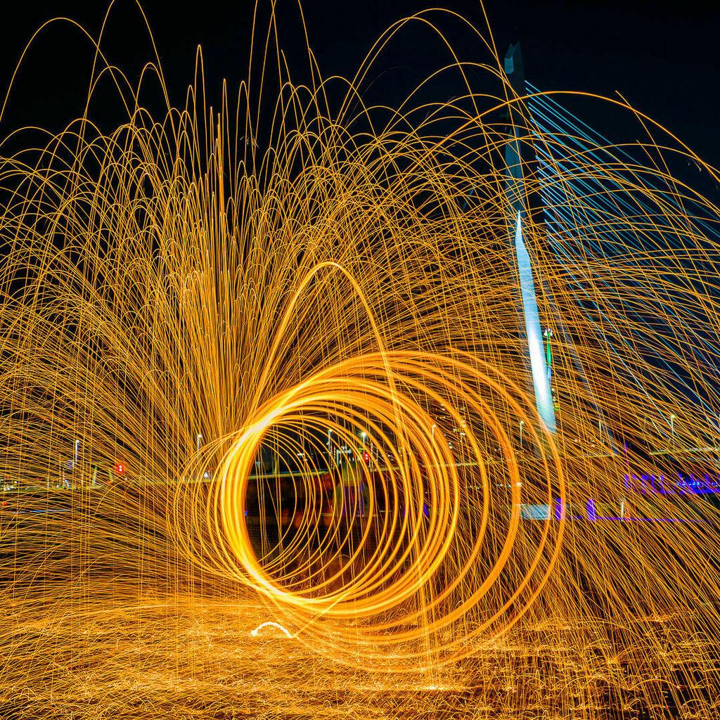 Rotterdam by Night - RPS Night Photography Workshop with Patrick van Dijk. Steel wool in front of Erasmusbrug. - The Netherlands - #architecture #bridge #circle #city #cityscape #dutch #fire #heat #light #longexposure #night #river #Rotterdam #steel #urb… https://t.co/ervim3WJNx https://t.co/0gXsmmAQQh