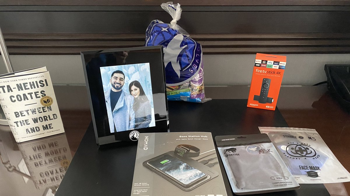 """spending the next two weeks inside the """"in-market bubble""""  I'm biased, but this Timberwolves welcome package is really cool.  framed photo of my wife and I was unexpected, but a really cool touch. love this organization. https://t.co/K2NayOXP81"""