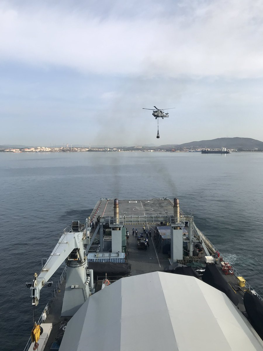 This is a VERTREP or Vertical Replenishment, used to transfer underslung loads of cargo by helicopter to a ship whilst underway. This is one of our Wildcats from @847NAS bringing equipment back to the ship after training in Gibraltar on #LRGX.