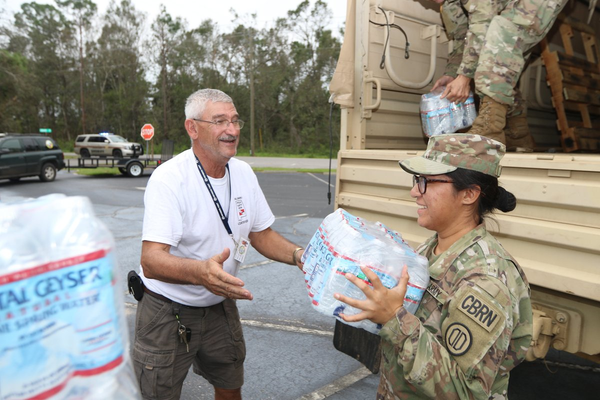 Photo of the Day: Pfc. Angela Sandoval, of the @AlabamaNG, hands out water to a local citizen affected by Hurricane Sally. https://t.co/Y74ktpgF4L https://t.co/6CnDj7C6xG