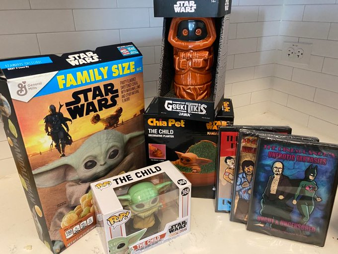 Enter our latest Patreon Contest to win this prize package of Mandalorian Baby Yoda memorabilia and more