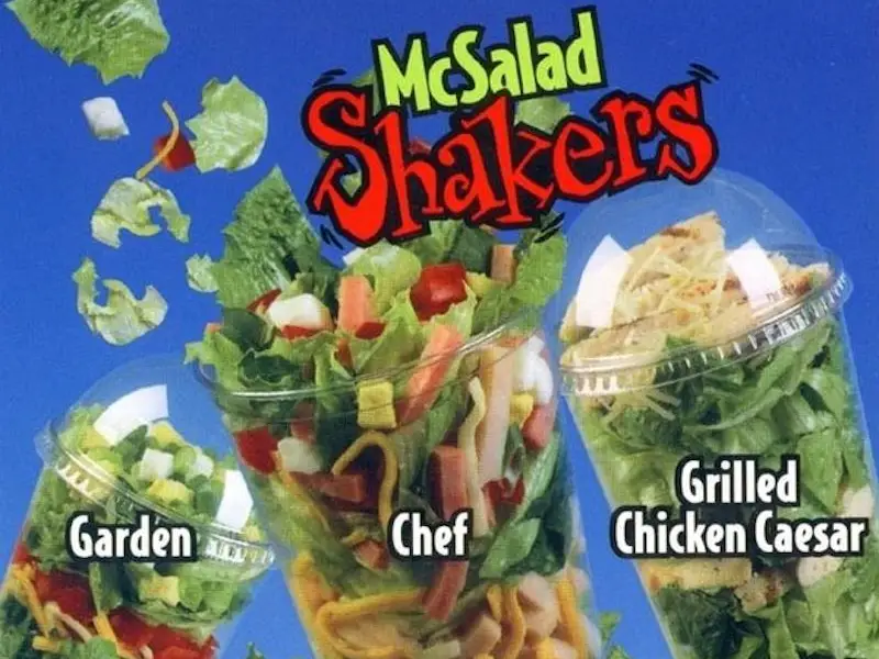 McSalad Shakers were introduced in 2000. It was served in a tall, clear cup with a domed lid that allows customers on the go to pour on their choice of dressing and shake it up, spreading the dressing evenly throughout. Discontinued in 2003. #popculture #salad https://t.co/vC4AD3CWly