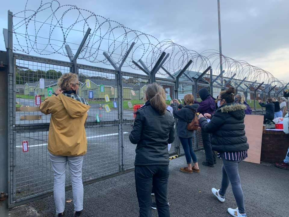 The do-gooders (mostly female) have arrived this morning to tie welcome messages of support for the 250 'male illegal migrants' staying at the Penally training camp near Tenby, Wales 🤦♂️ #Idiots https://t.co/InHBH42Iwd