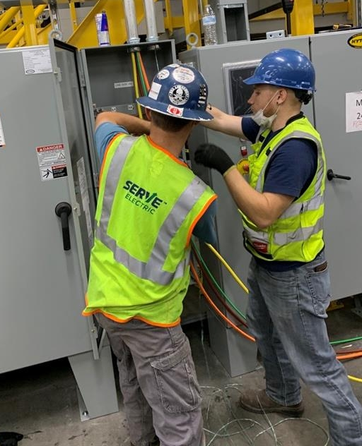 One pull done, another to go! Here the team is working on a newly terminated 400amp disconnect for a newly installed conveyor system...and oh did we mention it's a record breaker 860' conduit run! 😎