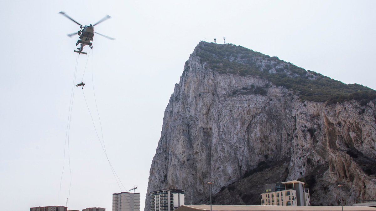 Just dropping in. In a stunning display of stealth and skill, #RoyalMarines of @42_commando abseiled more than 200ft from an @847NAS Wildcat helicopter during training in Gibraltar. 🔗Read more: ow.ly/Zcd250ByTkA