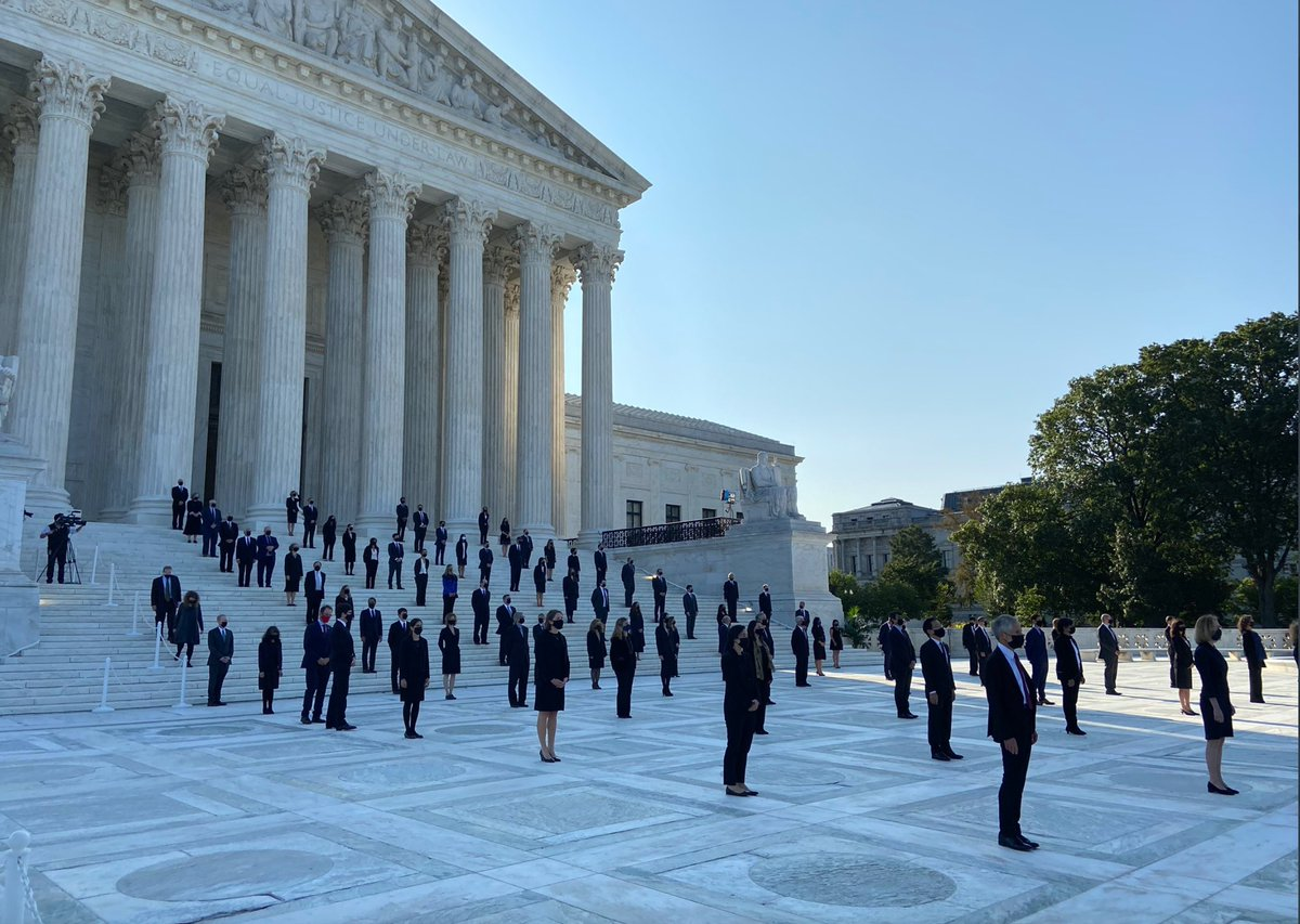 One hundred former law clerks to Justice Ruth Bader Ginsburg stand on the steps of the US Supreme Court to await the arrival of her casket. (via @lawrencehurley.) https://t.co/U3CzBJmV0M