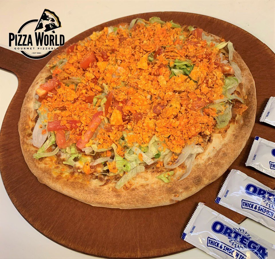 Pizza World's Baja Taco Pizza starts with a light layer of refried beans and add taco seasoned meat, mozzarella & cheddar cheese, topped with lettuce, tomatoes, crushed Doritos®, served with taco sauce on the side. (618)451-1111 https://t.co/Wl0u0CQx3B #pizza #pasta #salad #subs https://t.co/f5Mxn7ckl4