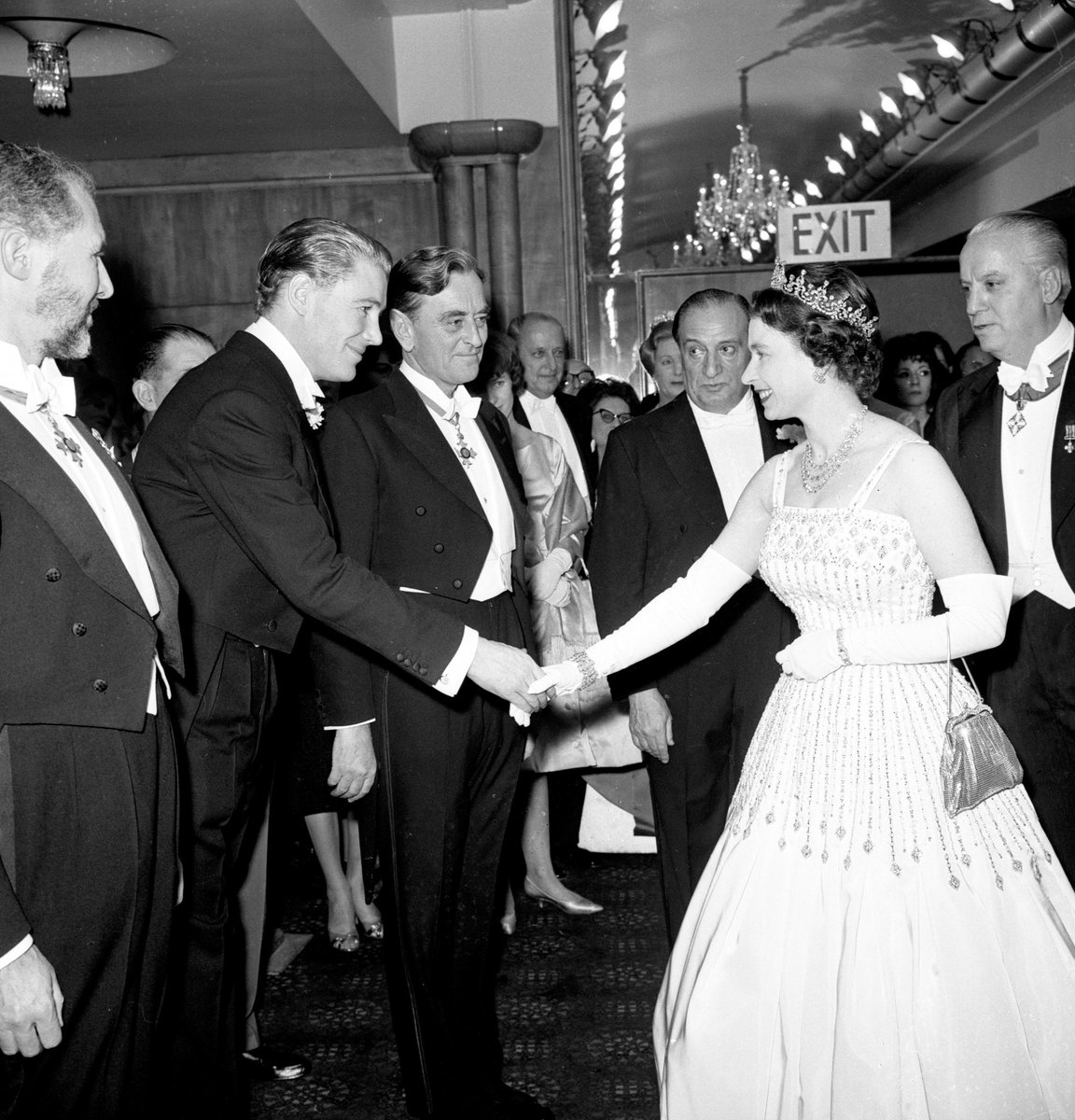 The dress, designed by the renowned British fashion designer Sir Norman Hartnell, was first worn by The Queen in the 1960's. 📸 Her Majesty wearing the dress at the premiere of Lawrence of Arabia' in 1962.