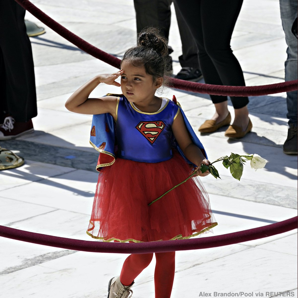 This little girl saluting Ruth Bader Ginsburg's casket on the steps of the US Supreme Court in her Superwoman costume with a rose in her hand just did me in. https://t.co/GgXb9Zjioh