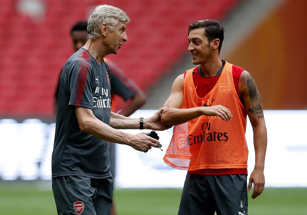 Arsène Wenger and Mesut Özil at the Bird's Nest in Beijing, 2017.