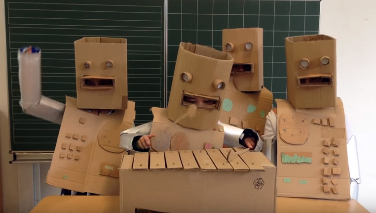 "Kraftwerk's ""The Robots"" Performed by German First Graders in Adorable Cardboard Robot Outfits   If you need a mental break from 2020  https://t.co/GM5o9D0kZB https://t.co/NrmLIXCPL8"