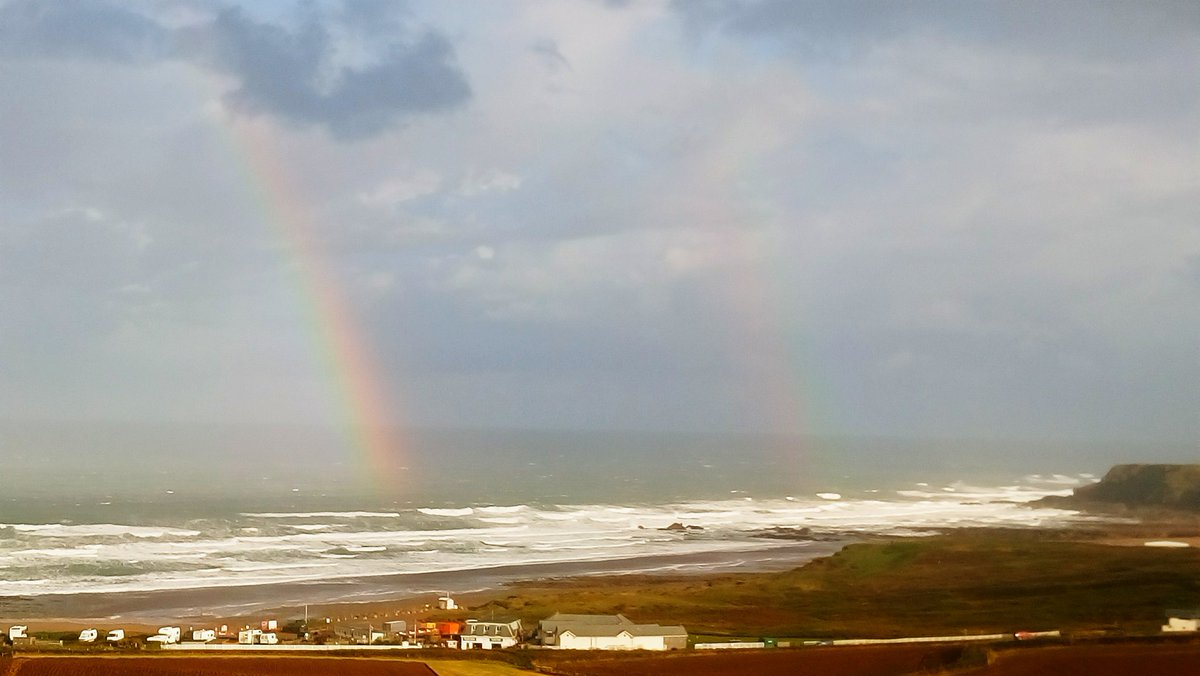 Double Rainbow into the Sea 🌈,  I didn't have my camera so the one on the right is very faint.   #Friday  #Rainbow  #windy  @TheStormHour  @ThePhotoHour  @metoffice  #Cornwall https://t.co/VRMTzwNiks