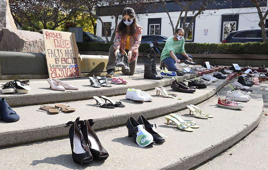 CLIMATE SHOE STRIKE: Over 200 pairs of shoes/boots lined the steps  out front #BurlON City Hall on this global day of action for climate, the shoes represented participants who would normally be present. Afterwards many of the shoes/boots will be donated to @CompassionSocie https://t.co/e8ZOxnm2OG