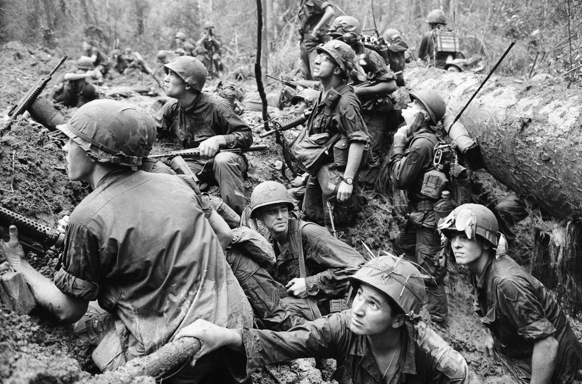 of him was shot to pieces...the very sea stained with American blood. The only blockers most had were the dead bodies in front of them, riddled with bullets from enemy fire.Take a knee in the sweat soaked jungles of Vietnam. from Khe San to Saigon...Anywhere will do. Americans