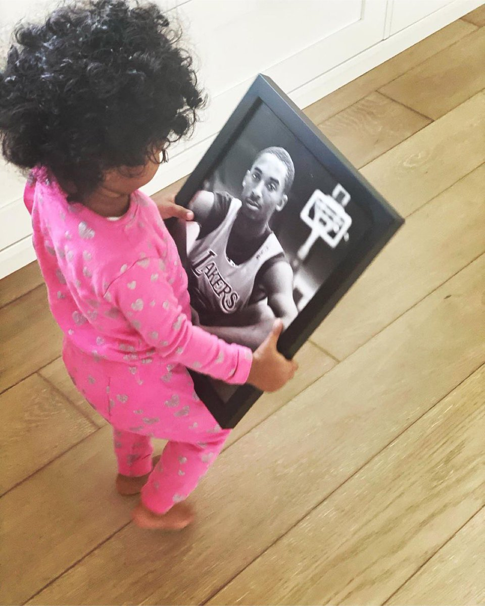 Capri Kobe Bryant looking at a picture of her father. 🥺💜💛  #MambaForever (via VanessaBryant/IG) https://t.co/5H9hgA6NMn