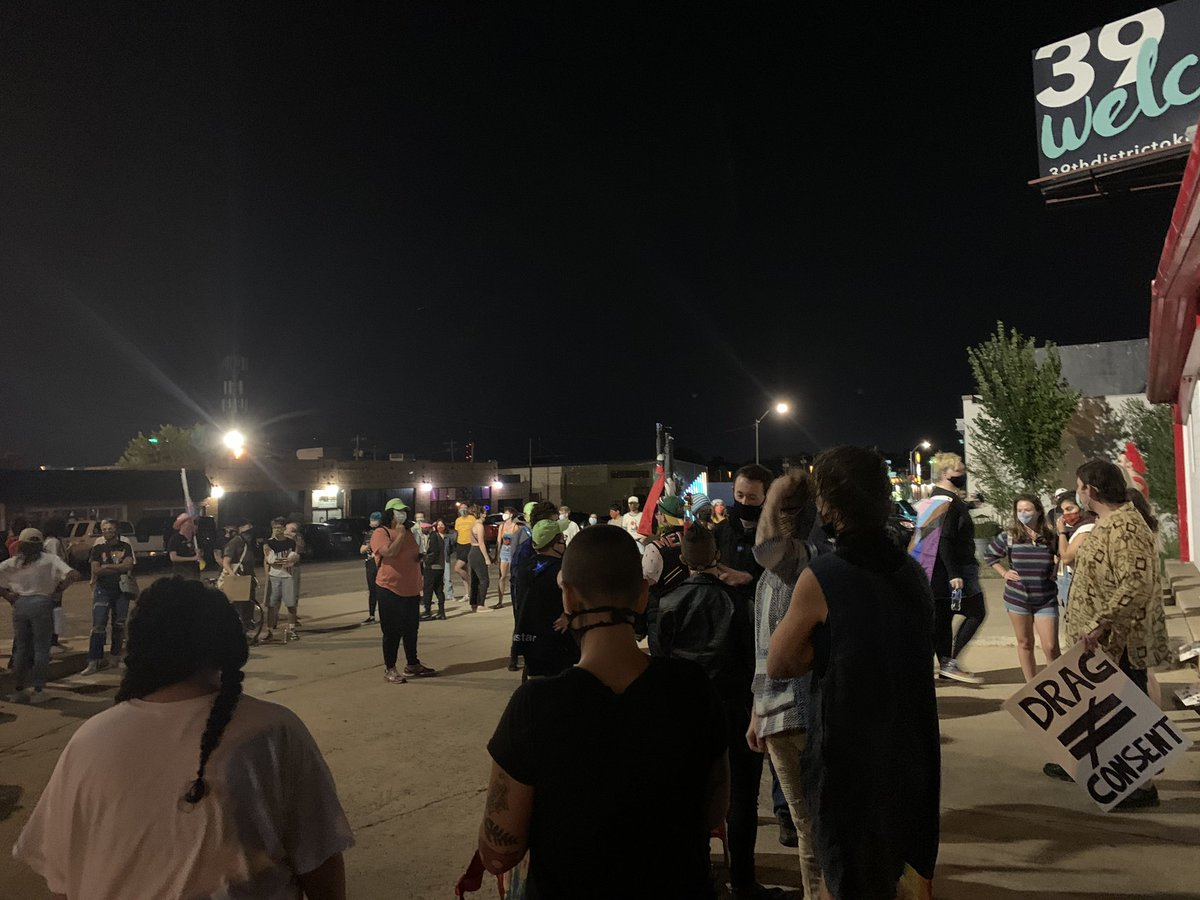 """I'm on 39th Street in OKC, where a group of demonstrators plans to protest """"oppressive"""" behavior alleged at one of the district's most popular nightclubs. Will tweet things of interest. https://t.co/xGfbs01OOF"""