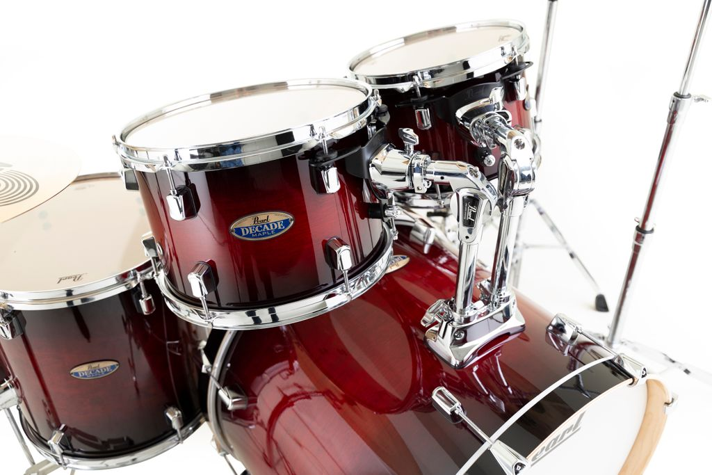 """Pearl's Decade Maple in Gloss Deep Red Burst. With feature-heavy shell packs, Decade Maple drums are perfect as a primary kit for evolving players, or a secondary """"gigging"""" kit for the seasoned pro.  Iconic Sound. 100% Maple. Revolutionary Price. https://t.co/33jtzhLekN https://t.co/eynH7NtURn"""