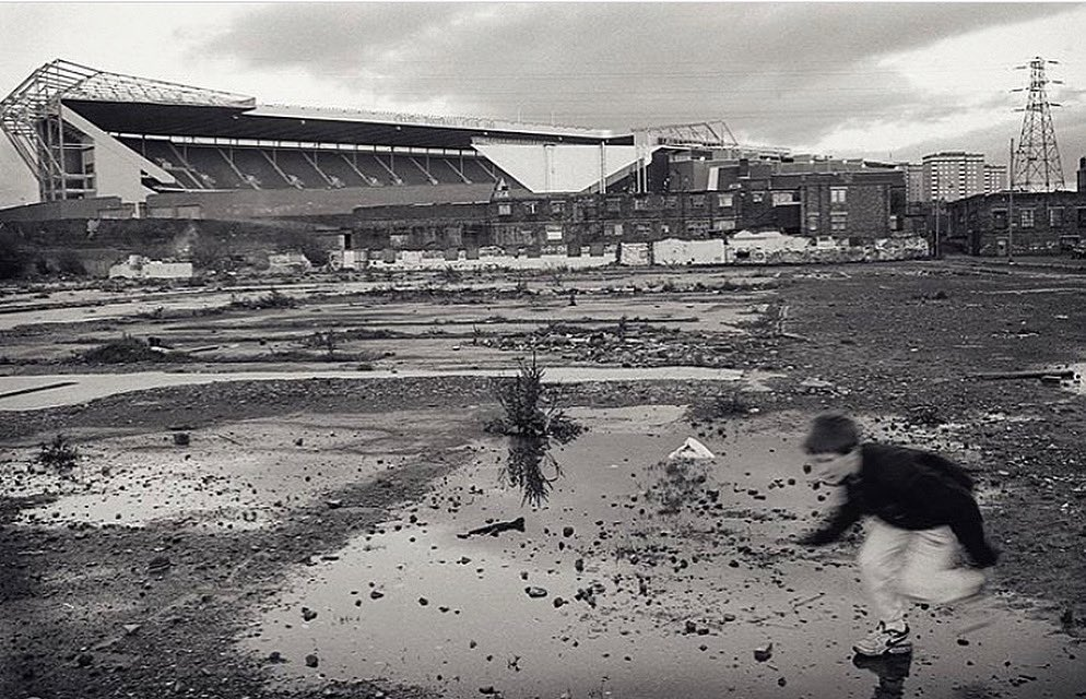 Boy running on wasteland in the shadow of Celtic Park. Glasgow, 1995. From our featured photographer Tony Davis.