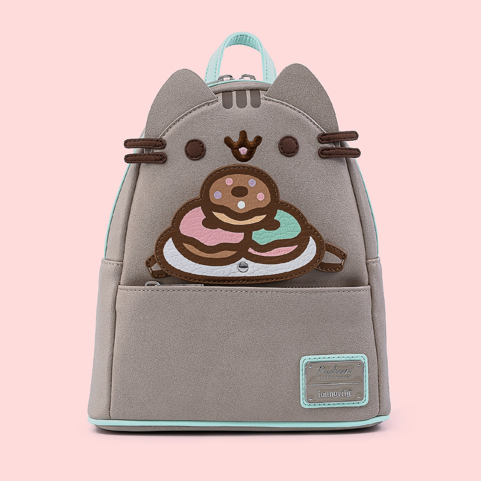 The cutest new #Pusheen collection has just arrived at @Loungefly! Choose from two adorable backpack designs plus a colorful donut purse 🍩 Shop the entire collection via the link 😻 bit.ly/3jJbuFQ