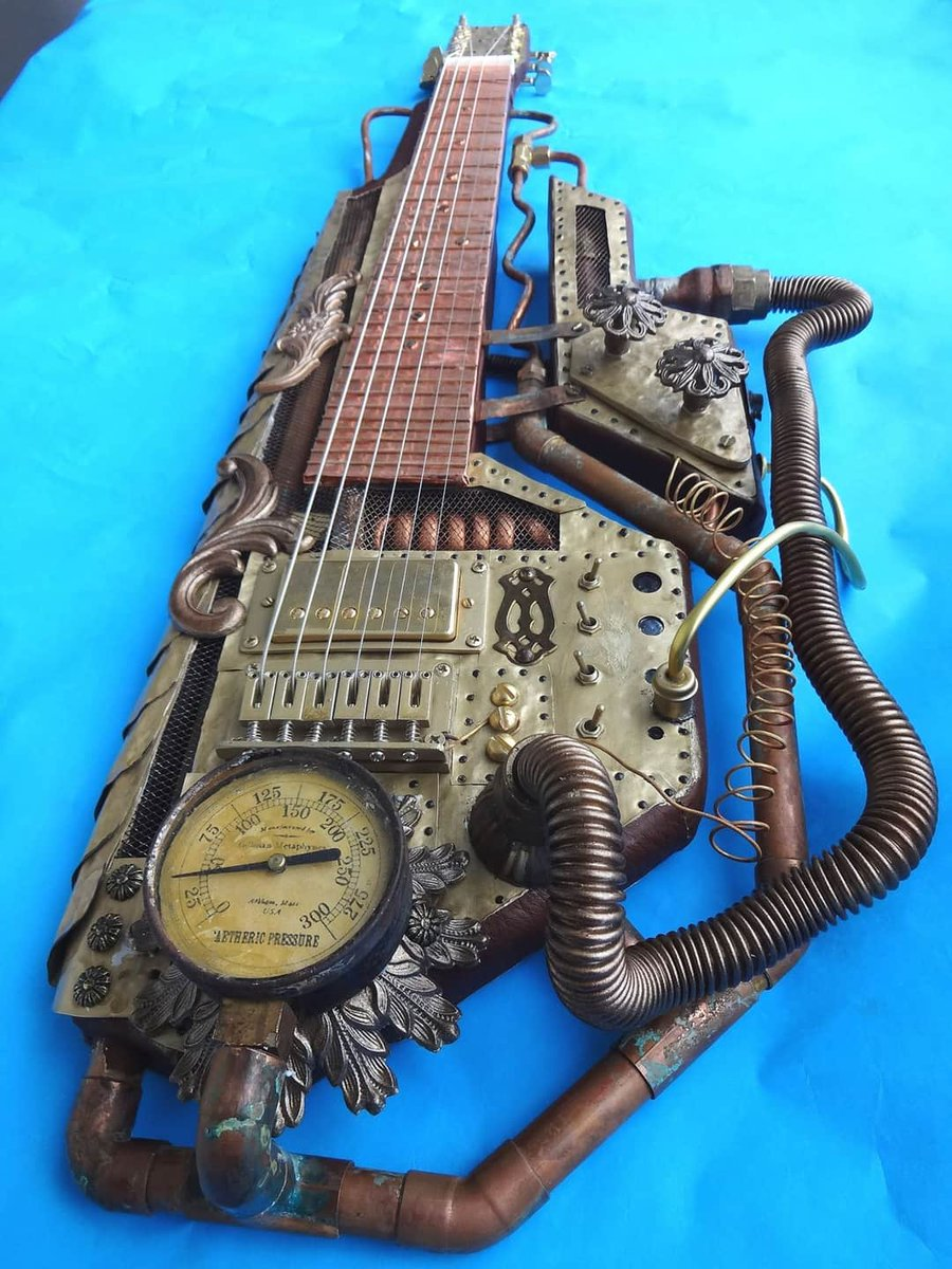 #Steampunk ⚙️ Awesome of the Day ⭐ ➡️ Customized Lap Steel #2 #Guitar 🎸 With Copper Brass Tubing Hammered Metal & Old Gauge via @GeorgeLiros ➡️ Visit https://t.co/oUGw4npkY5 For More! #SamaGuitars #SamaMusic 🎶