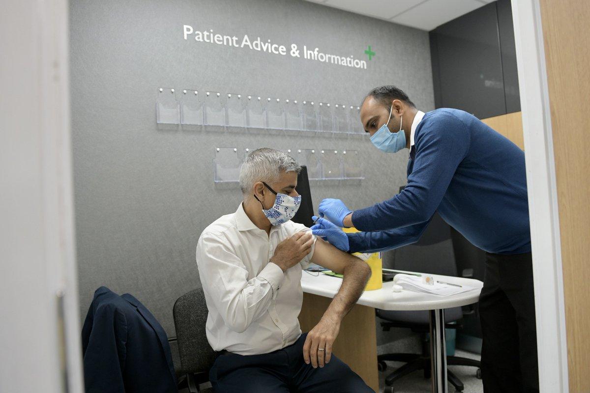 Mayor of London, Sadiq Khan, is administered a flu jab at a pharmacy.