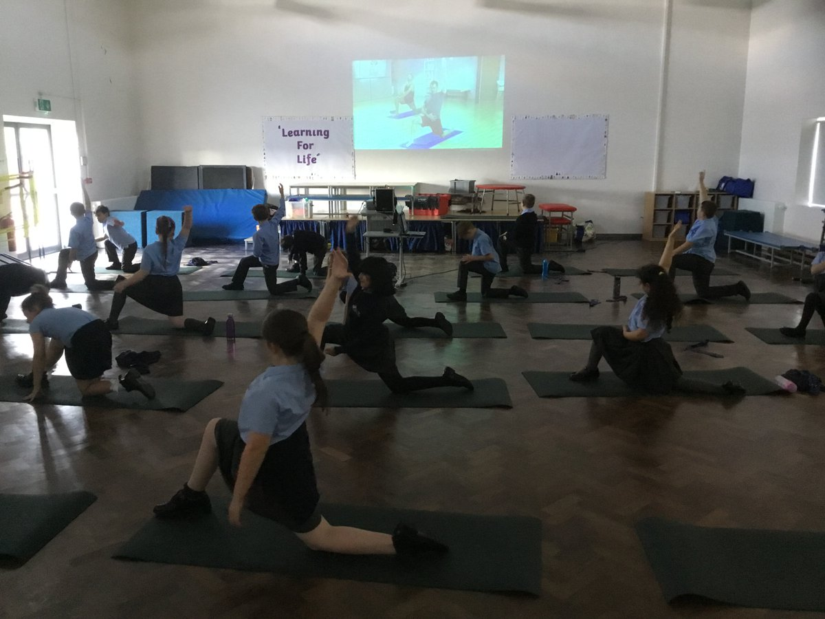 @AHMrStevenson class taking part in a yoga session this afternoon. Great for the mind and body. #wellbeing #exercise #health #yoga https://t.co/EqdfkRXef1