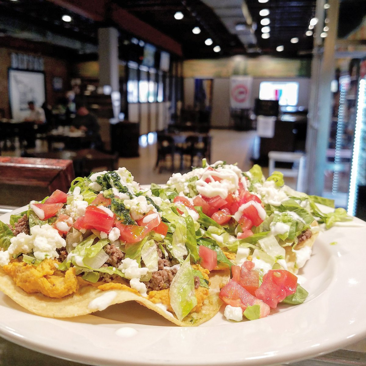 Tostadas Tuesday!   Lamb, Hummus, Goat Cheese, Lettuce, Tomato, Crema, & Chimichurri   Enjoy these all day for curbside and dine in, or at our Trivia Night tonight at 6:30!   #tostadas  #familyowned  #triviatuesday  #supportlocal https://t.co/VmFGnGOzWD