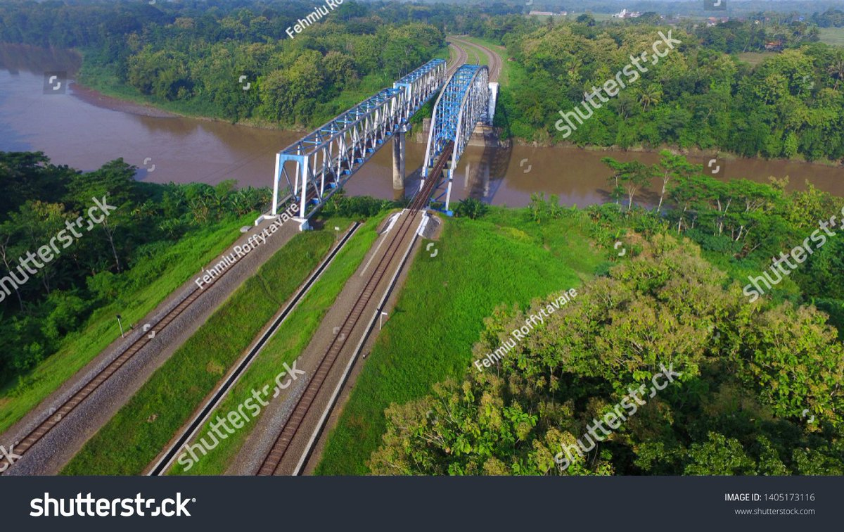 double track of train lines and #railway #bridge. #Infrastructure of #transportation in #Indonesia  photo ID: 1405173116  #train #aerial #track #way #railtrain #industry #daily #news #today #photostock #shutterstock #pupr #development #asia #construction https://t.co/R47HngIm6G