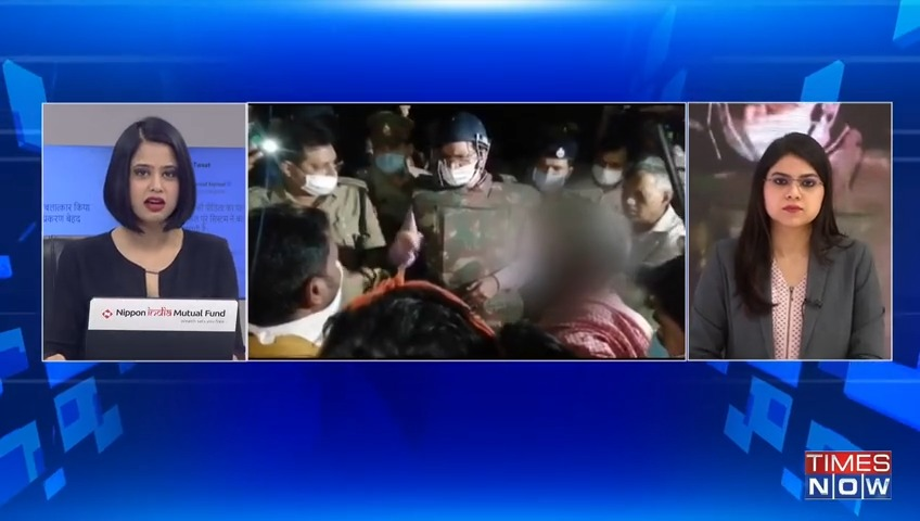 U.P Police cremated body of the #Hathras gang-rape victim. Administration claims all rituals were performed, family members cooperated. Victims parents allege they werent allowed anywhere near body & cops forcefully went ahead. Watch top reactions. Ground report: Parvina.
