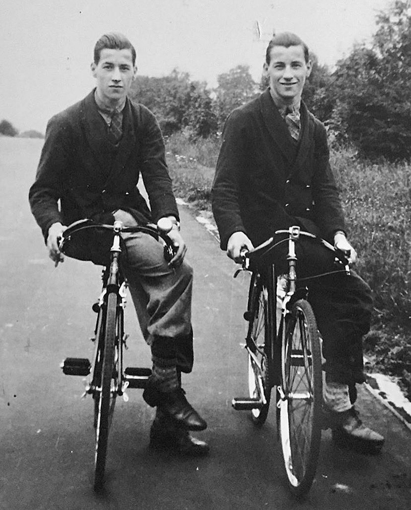 "Twins George and Albert Ellis aged 16. Stow-On-The-Wold, 1937. Photo submitted by George's grandson Karim. Karim ""My grandad George Ellis and twin brother Albert. Pictured working as delivery boys for a grocers in Moreton-in-Marsh""."