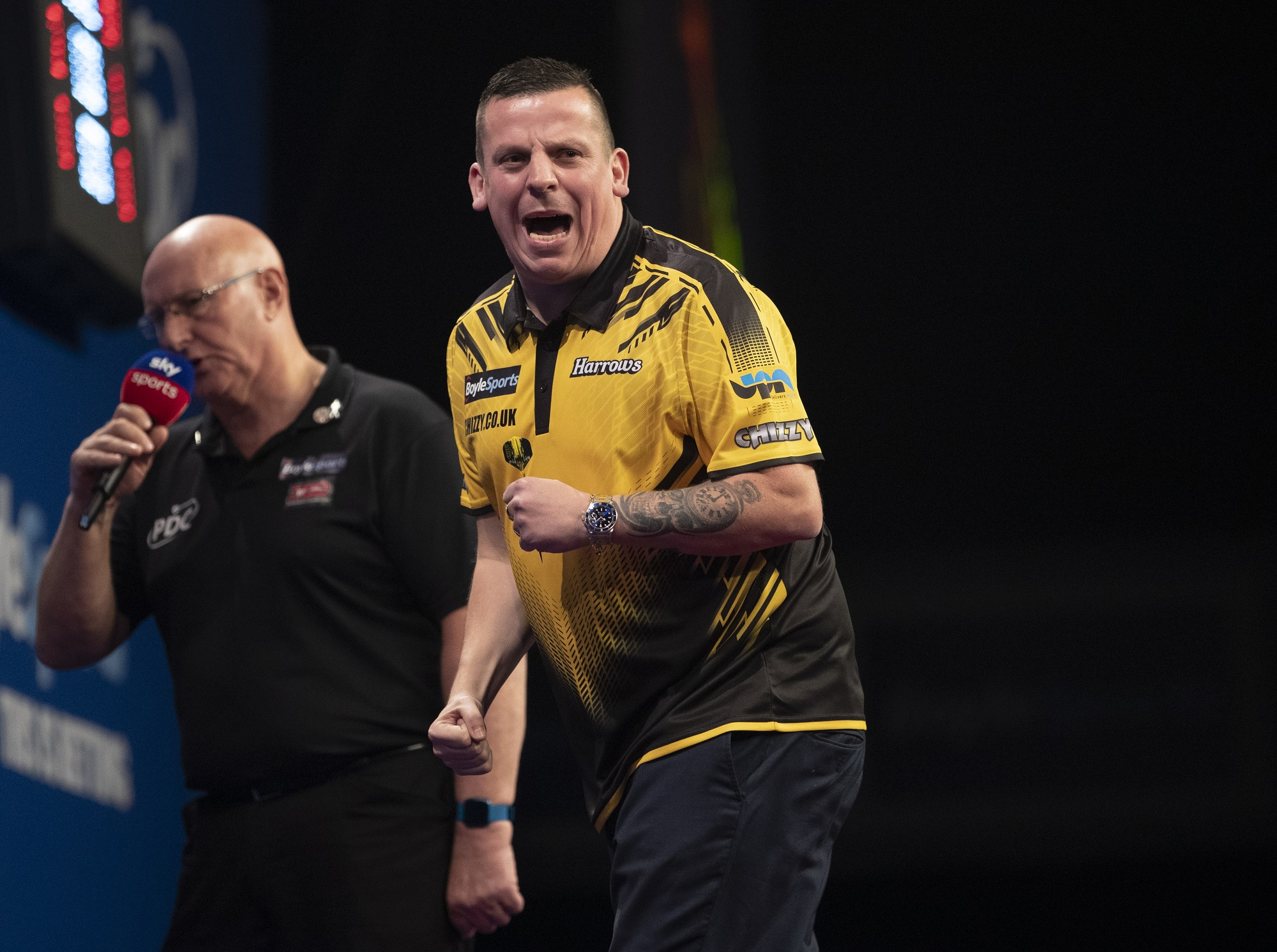 Chisnall is two victories away from emulating last year's run to the final (Photography: Lawrence Lustig/PDC)