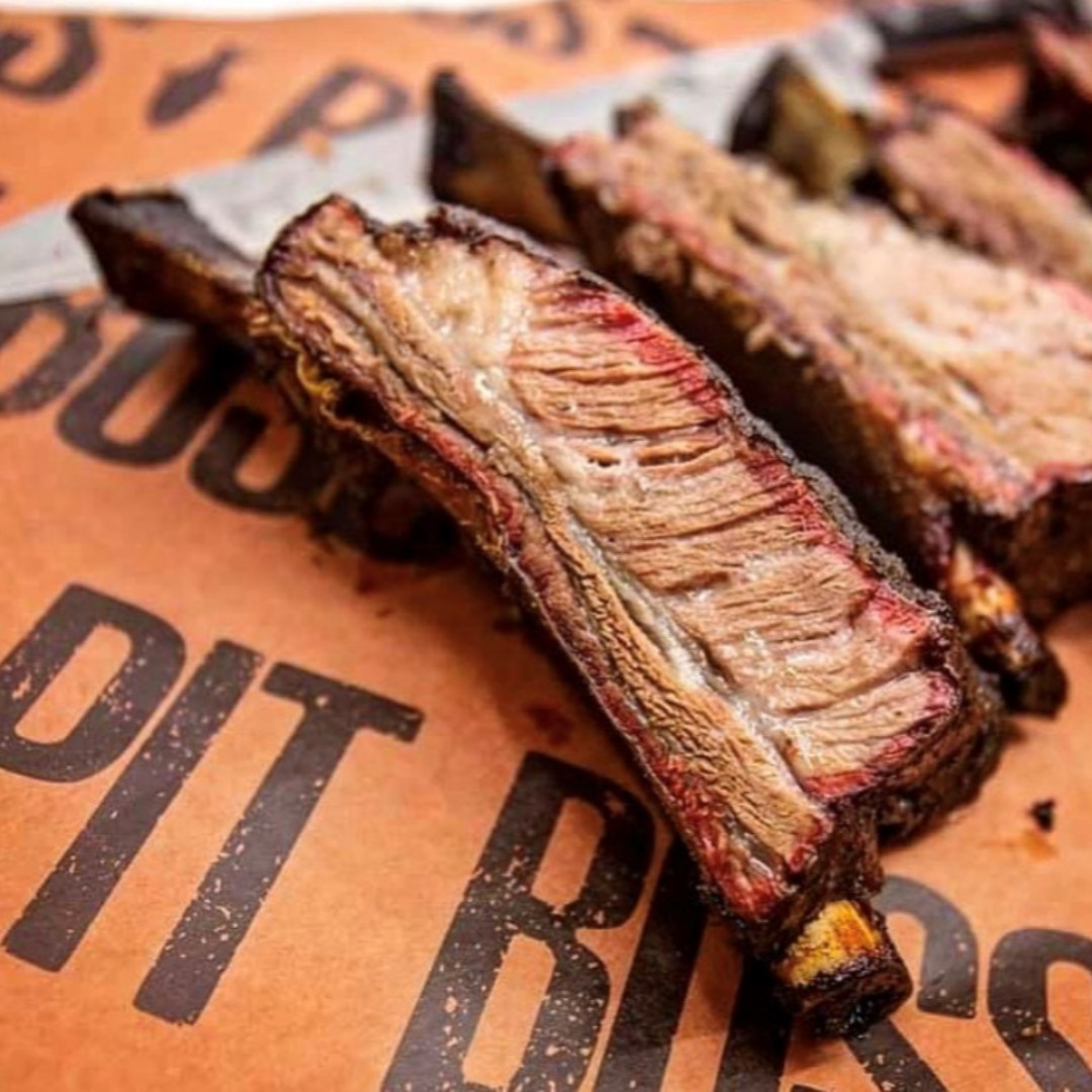 """""""Definitely one of my favourite things in the world. Big rig beef ribs smoked on the @pitbossgrills. Just some salt, pepper & a whole lot of love."""" - Kevin F.  Wrap your next rack in the Pit Boss Butcher Paper! Buy 1, Get 1 for a limited time at: https://t.co/QOzWF5Jad4 https://t.co/V7cwQqoTgt"""