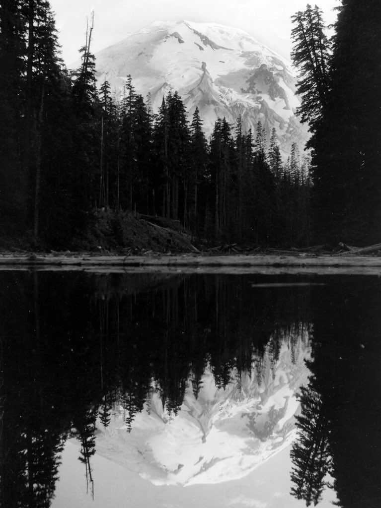 A crystalline reflection of Mount St. Helens seen in the mirror of Spirit Lake five decades before the eruption that changed the landscape forever #Throwback #History https://t.co/PUYRU7djM0