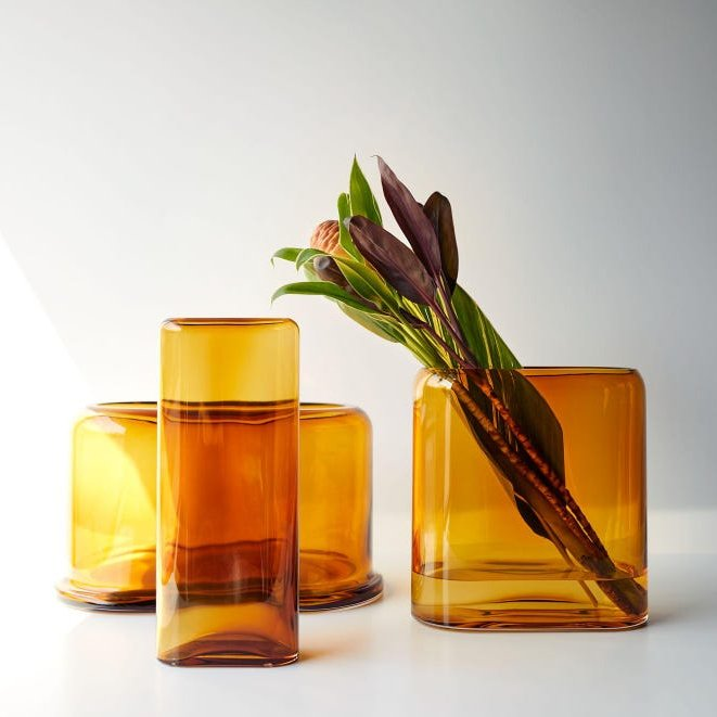 """#designoftheday Unison's """"Amber Layers"""" collection of glass vases pay homage to traditional handblown glassmakers. These sculptural pieces, handmade in Turkey, work as a grouping or nested for showing off your fall arrangements. The color is beautiful. https://t.co/kyXF0IGpz0 https://t.co/RB7YBjSADk"""
