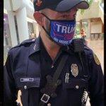 Image for the Tweet beginning: Miami Cop Wearing Trump Mask