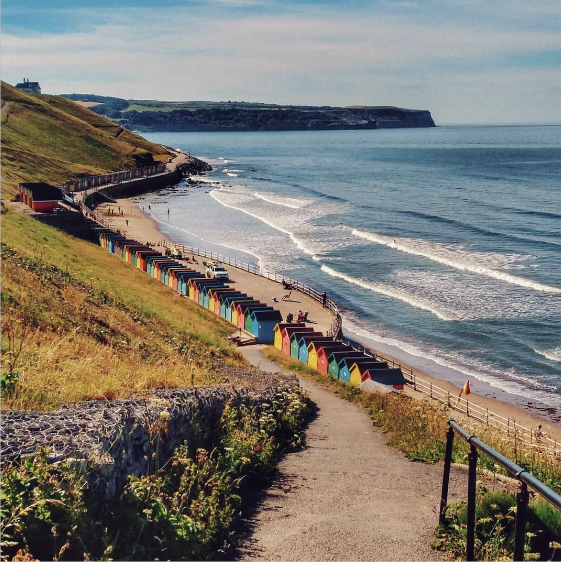 📍Whitby, North Yorkshire The iconic rainbow beach huts lining the West Beach of Whitby's coastline. (📸IG/pics_of_a_lonesome_dreamer)