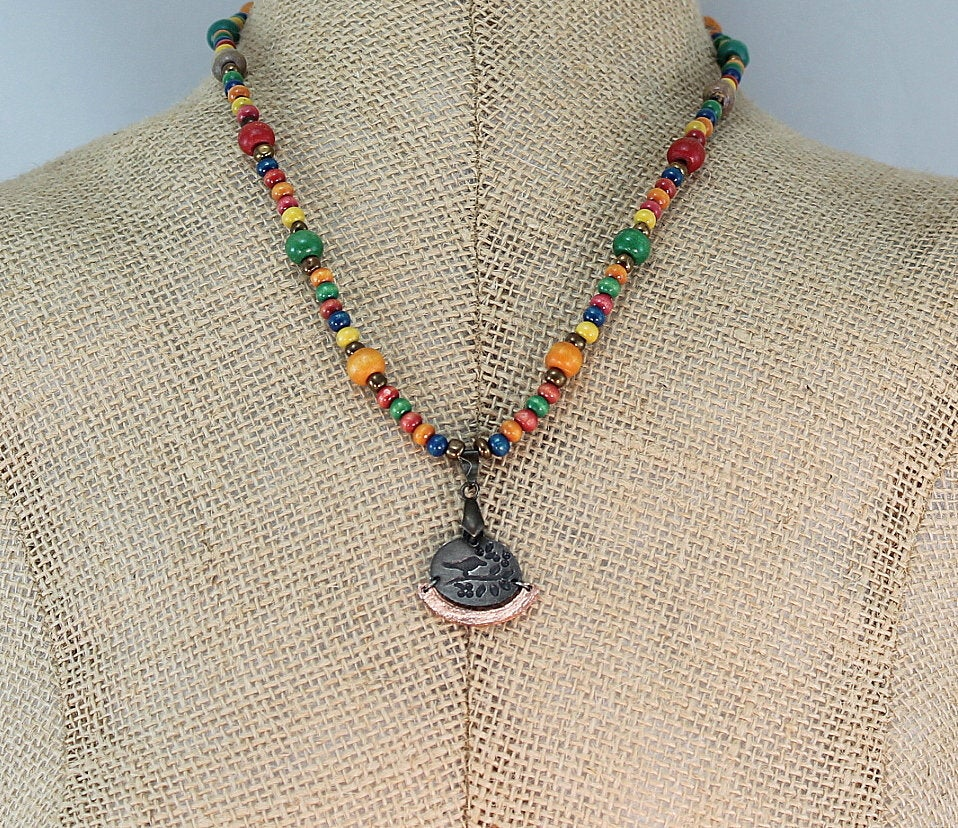 Sharing for Donna Johnson on Etsy  Really love this, from the Etsy shop BlingbyDonna. https://t.co/R6VUJbdfvW #etsy #giftforher #pewterandcopper #mixedmetalpendant #woodbeads #colorfulnecklace #womannecklace #bohemiannecklace #birdpendant #multicoloredjewelry https://t.co/GZd0JvCe7G