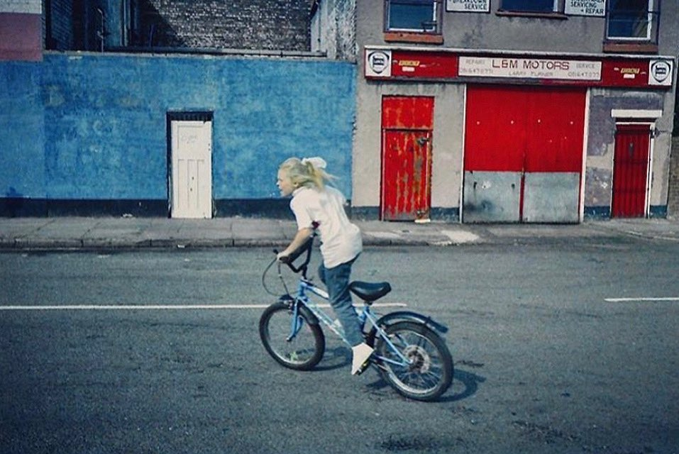 Girl on a Grifter. Birkenhead, Merseyside, late 1980s. From the archive of photographer @NickWynne3