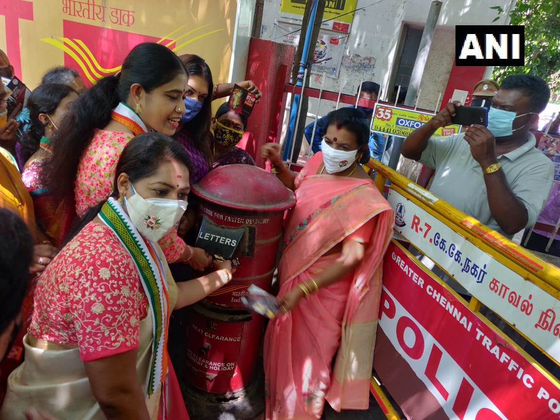 """Tamil Nadu: State Mahila Congress workers stage a protest outside Chennai's KK Nagar post office by mailing postcards to PM Modi & UP CM asking them to stop shaming victims.  """"Our postcard protest will continue until we get justice for women"""" says S Vijayadharani, Congress MLA"""