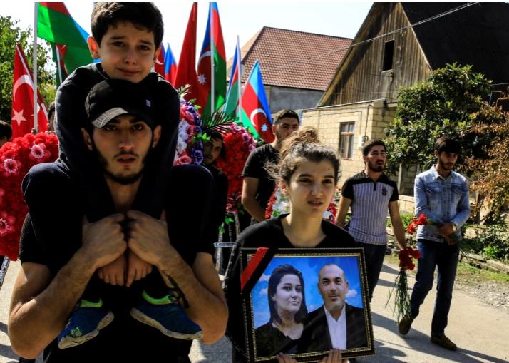 Eight year old Huseyin Aliyev at the funeral of his parents killed by shelling in Azerbaijan #stopbombingcivilians aljazeera.com/news/2020/10/1…