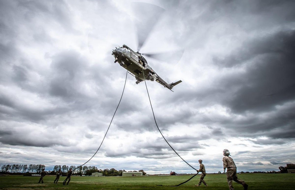 """We have that #FridayFeeling so we thought we'd set a caption competition. The winner gets kudos and maybe an RAF pen if we have one that nobody has touched recently. A starter for ten from our @Joint_Heli team: """"Taking the big cat for a walk"""" Can you do better❔"""