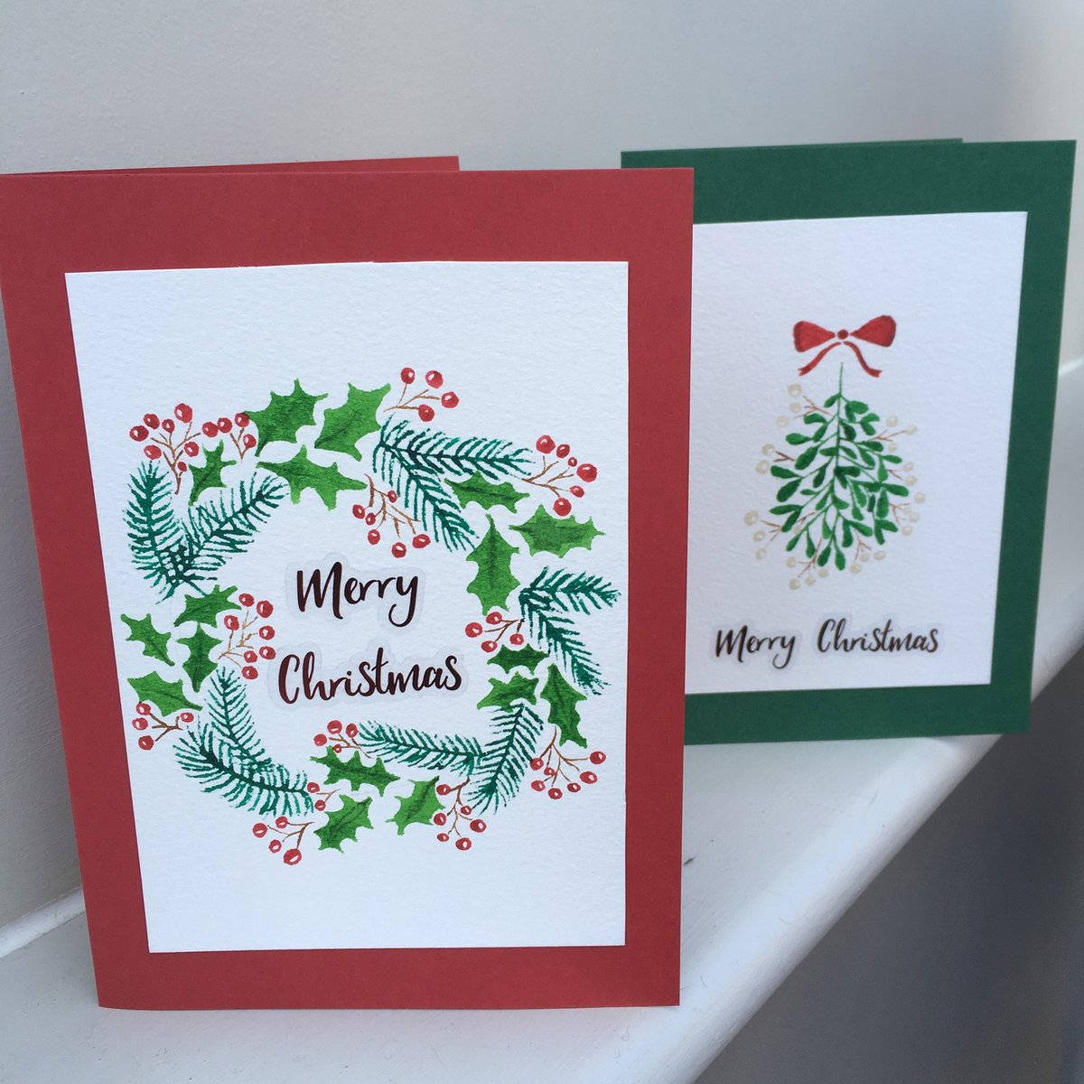 These watercolour wreath and mistletoe Christmas cards were painted by Naomi and uploaded into our Christmas Craft Competition. How pretty!   Enter our competition for a chance to win £100: https://t.co/vm4Y3J8xXy  #CraftTogether #Competition #Hobbycraft https://t.co/1TSAM5cu0j