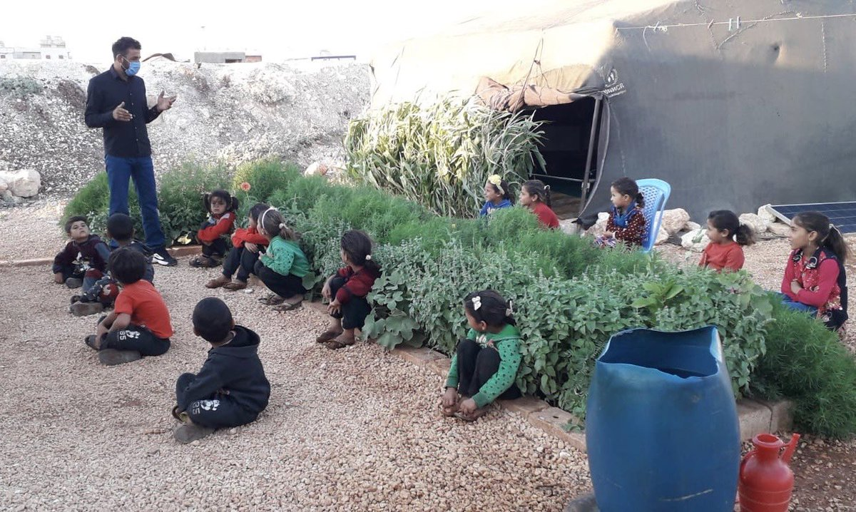 This is what school looks like for many children in Idlib, northwest #Syria . Outside, under the olive trees... @UNICEF and others are supporting many of these mobile teachers, but it's not enough. Idlib needs more schools and more rehabilitation of damaged schools