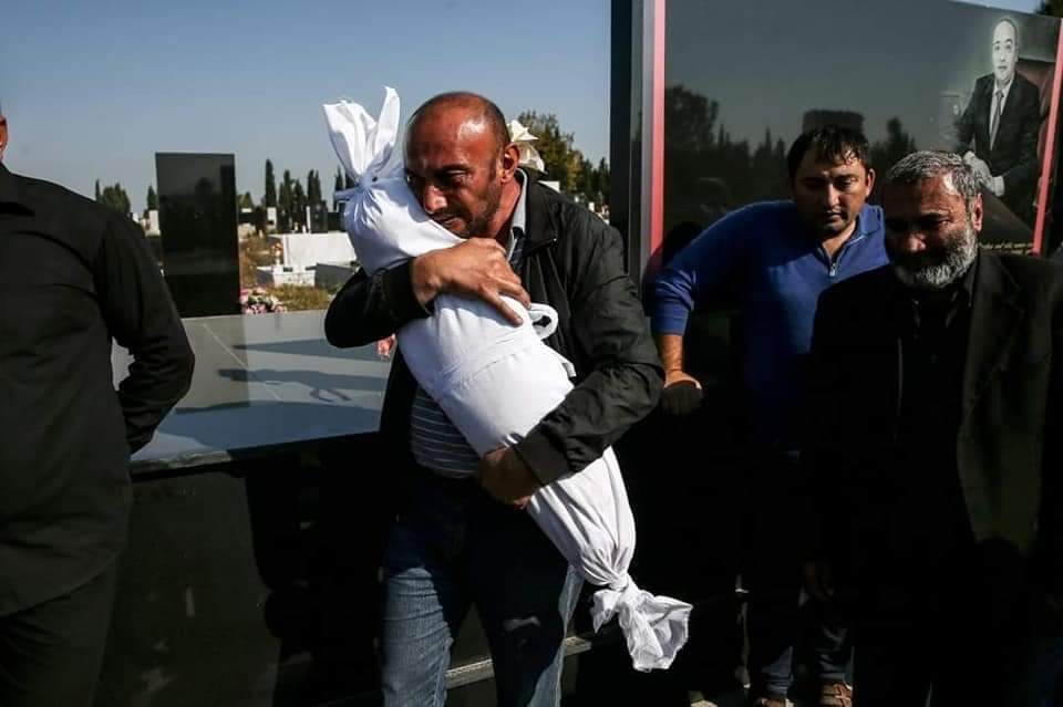 Timur Xaligov carries his 10-months-old daughter, Narin, who was killed with five other relatives, including her mother Sevil, when missiles launched by #Armenia hit their home in #GanjaCity. #StopArmenianTerrorism #StopArmenianAggression #StopAttackingCivilians