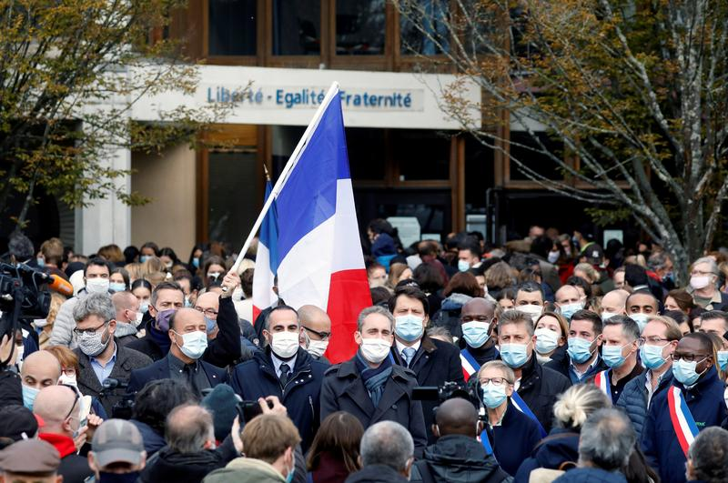 Tribute planned for beheaded teacher in France; 11th person arrested Photo
