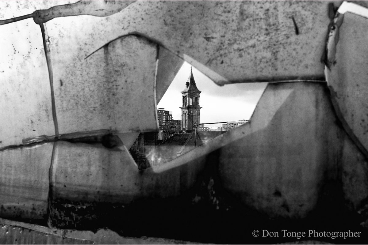 Damaged perspex walkway at the Deansgate rail station Manchester 2012 showing a view of the former Knott Mill Chapel. © Don Tonge