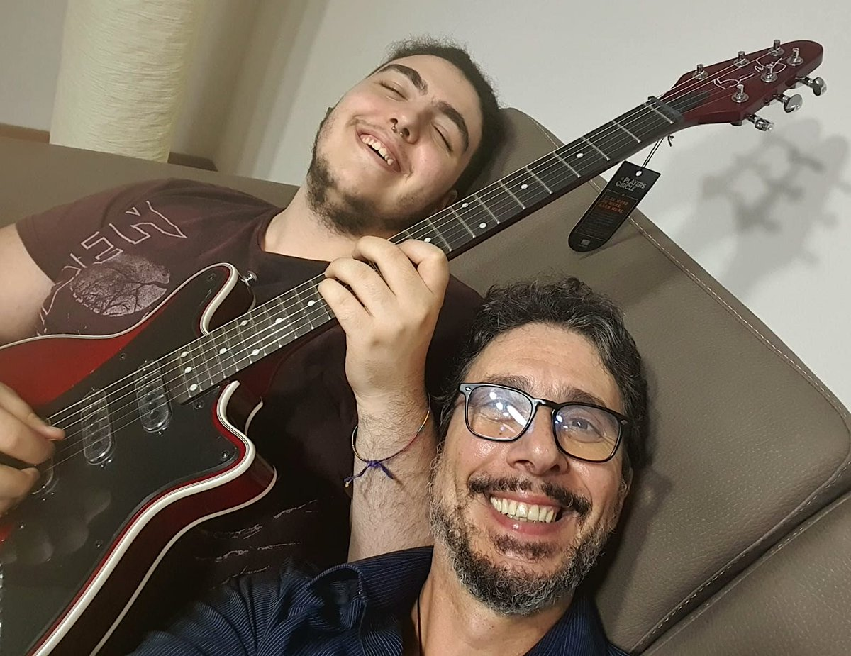"""BIG BMG SMILES ALL AROUND from father + son, Lorenzo and Dante Gioia, in beautiful Reggio di Calabria, southern Italy... """"I would like my thanks as a father to go personally to @DrBrianMay. Together with the @BrianMayGuitars team, you have made a boy very happy - Thank you all!"""""""